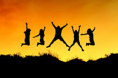 Group of friends jump on the top of mountain Stock Images