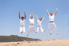 Group friends jumping Royalty Free Stock Image