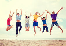 Group of friends jumping on the beach. Summer, holidays, vacation, happy people concept - group of friends jumping on the beach Stock Photography