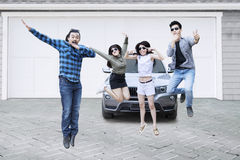 Group of friends jumping on garage stock image