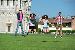 Group of Friends Jumping with Pisa Leaning Tower royalty free stock photography