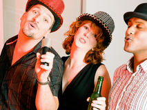 Group of friends at karaoke party Royalty Free Stock Photography