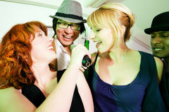 Group of friends at karaoke party Royalty Free Stock Photo