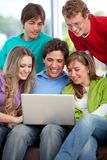 Group of friends with a laptop Stock Photo