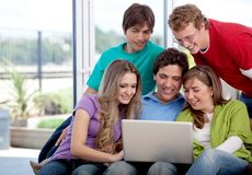 Group of friends with a laptop Stock Image
