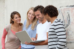 Group of friends with laptop Royalty Free Stock Photos