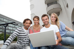 Group of friends with laptop Stock Photo