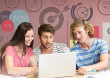 Group of friends with laptop sitting in front of  time and target graphics Royalty Free Stock Image