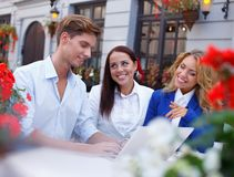 Group of friends with laptop Royalty Free Stock Image