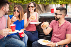 Group of friends laughing at a barbecue Stock Images