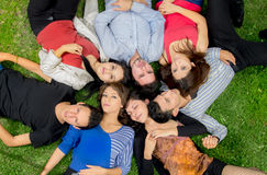 Group of friends laying down in park Royalty Free Stock Images