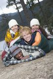Group Of Friends Lie In Sleeping Bags Stock Image