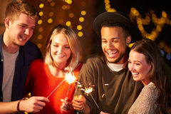 Group Of Friends Lighting Sparklers At Outdoor Party Stock Photos
