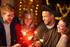 Group Of Friends Lighting Sparklers At Outdoor Party Royalty Free Stock Images