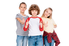 Group of friends looking at camera. Cheerful kids gesturing thumbs up sign isolated on white Stock Photo