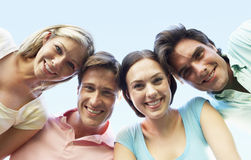 Group Of Friends Looking Down Into Camera Royalty Free Stock Image