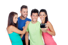 Group of friends looking a photo Royalty Free Stock Photography