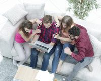 Group of friends looking at the photo on the laptop. Stock Photos