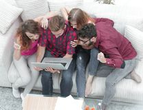 Group of friends looking at the photo on the laptop. View from the top. a group of friends looking at the photo on the laptop Royalty Free Stock Photography