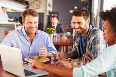 Group of friends at lunch in a restaurant Royalty Free Stock Images