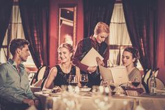 Group of friends in a luxury restaurant Stock Photo