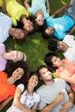 Group of friends lying down in park Stock Photo