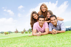 Group of friends lying outdoors Royalty Free Stock Image