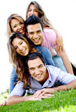 Group of friends lying outdoors Stock Images