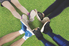 Group of friends make foot circle Stock Photo