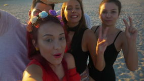 Group of friends making silly faces and fooling around on a video chat call stock footage