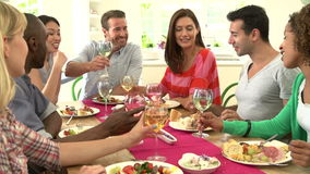 Group Of Friends Making Toast Around Table At Dinner Party stock footage