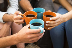 Coffee with friends. Group of friends making a toast with coffee Royalty Free Stock Image