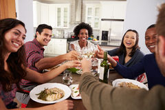 Group Of Friends Making A Toast At Dinner Party Stock Image