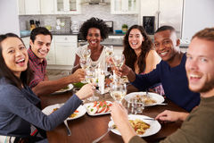 Group Of Friends Making A Toast At Dinner Party Stock Photos