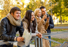 Group of friends with map and camera outdoors Royalty Free Stock Photo