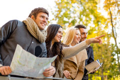 Group of friends with map outdoors Stock Photo