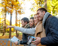 Group of friends with map outdoors Royalty Free Stock Image