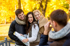 Group of friends with map outdoors Stock Photos