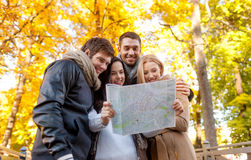 Group of friends with map outdoors Stock Photography