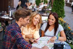 Group of friends with map Royalty Free Stock Photo