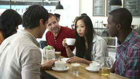 Group Of Friends Meeting In Coffee Shop stock video footage