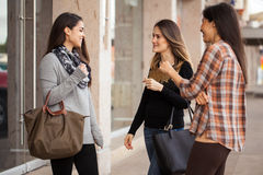 Group of friends meeting at the mall. Three young Latin women meeting at an outdoor mall and getting ready for some shopping Stock Photo