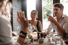 Group of friends meeting at restaurant for dinner Stock Images