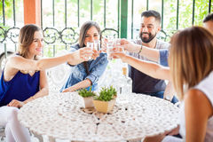 Group of friends in a Mexican party. Five good looking Latin friends having fun in a Mexican party drinking tequila shots outdoors royalty free stock photo