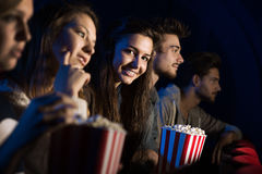 Group of friends in the movie theater Royalty Free Stock Image