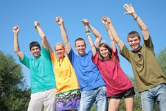 Group of friends in multicolor  shirts Royalty Free Stock Image