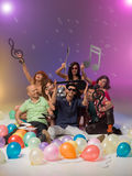 Group of friends with musical notes and balloons Royalty Free Stock Images