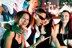 Group of friends in nightclub Royalty Free Stock Images