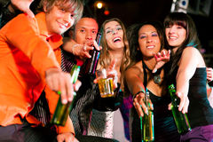 Group of friends in nightclub. Group of friends - men and women of different ethnicity - having fun in a disco or nightclub Royalty Free Stock Image
