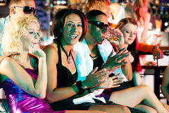 Group of friends in nightclub stock photo